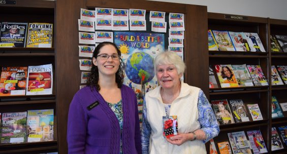 Eileen Workman (right) won a $50 gift card. Pictured with librarian Allison Wilkos (left)