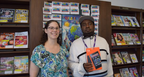 Steve Cooper (right) won a Kindle Fire. Pictured with librarian Allison Wilkos (left)