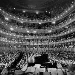 opera hall with piano and music stands facing audience